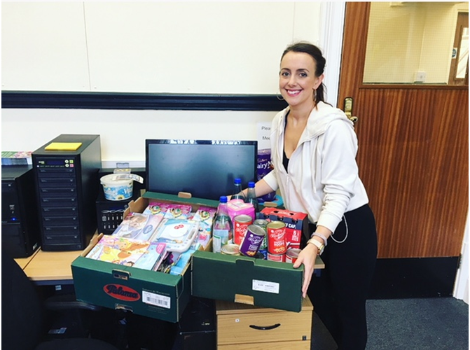 Cassie with the generous donation from Tesco