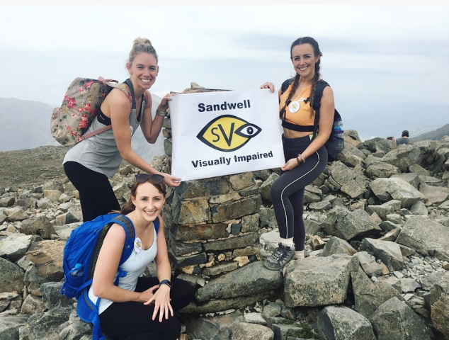 Cassie and her friends at Scafell Pike summit with SVI logo