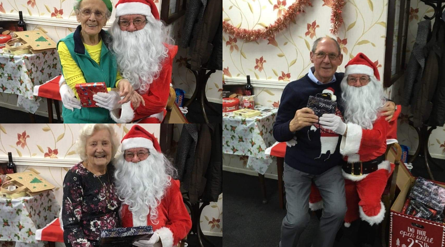 Active 60 members get presents from Santa (sitting on his lap)