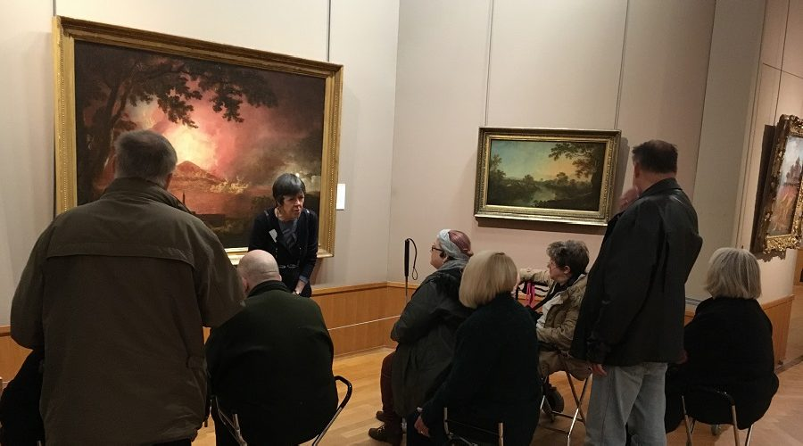 Describing a picture of Mt Vesuvius erupting